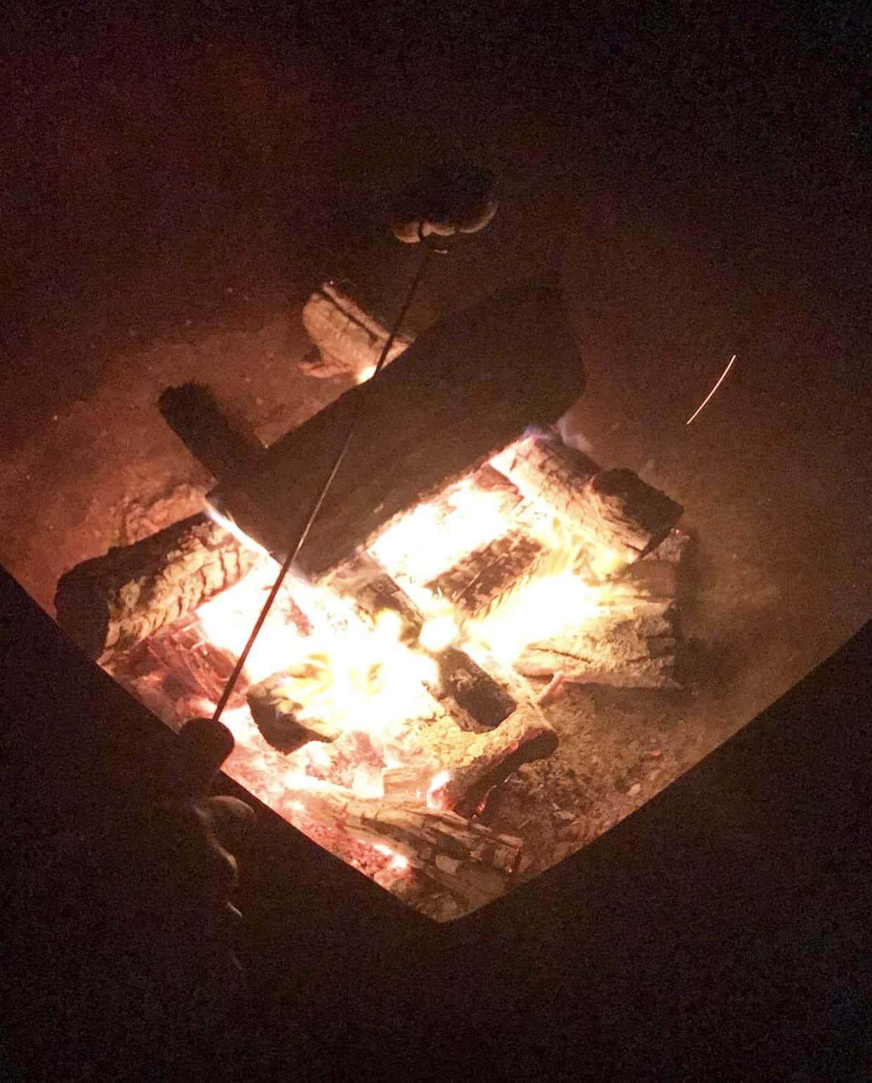 inns of aurora night bonfire