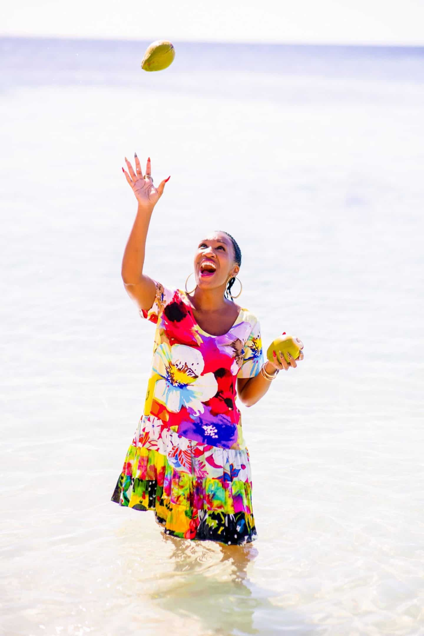 Shaunda Necole- Juggling coconuts on the beach in Honduras! Carnival Cruise Line - Vista - land excursion