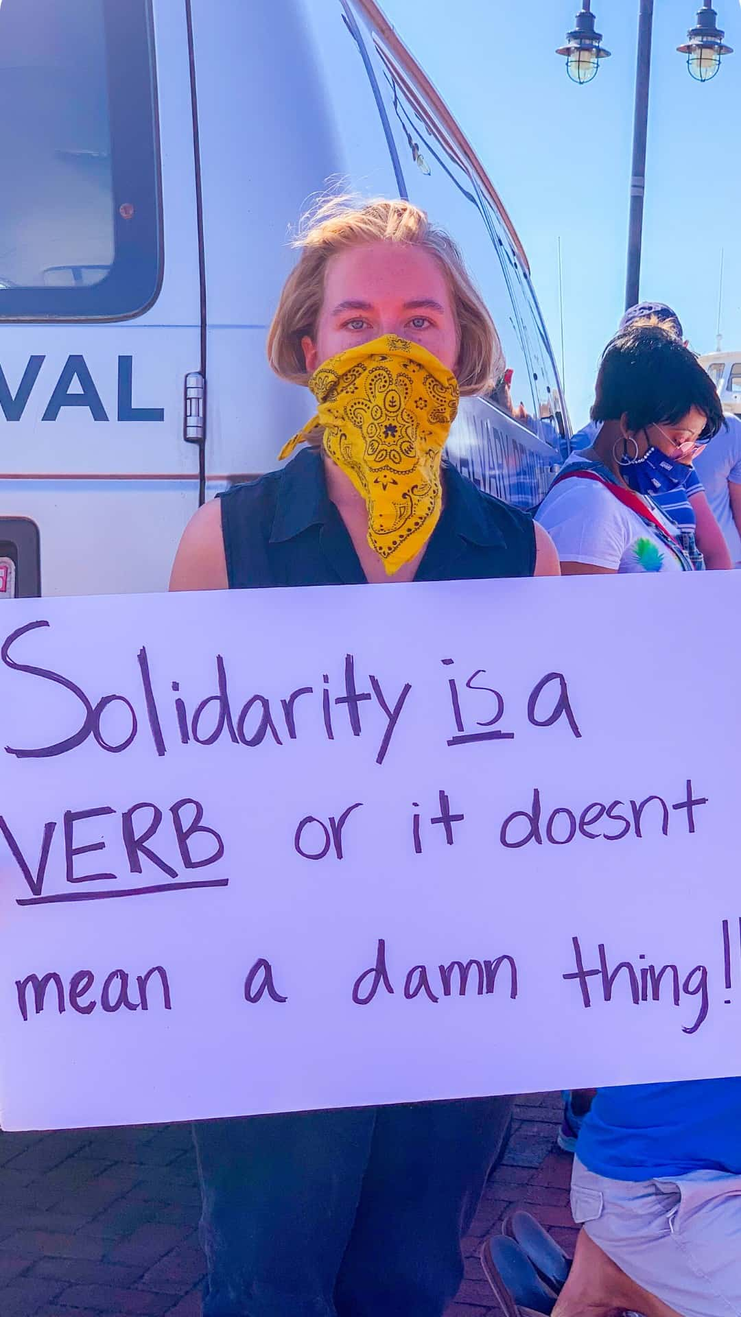 Solidarity is a verb protest sign