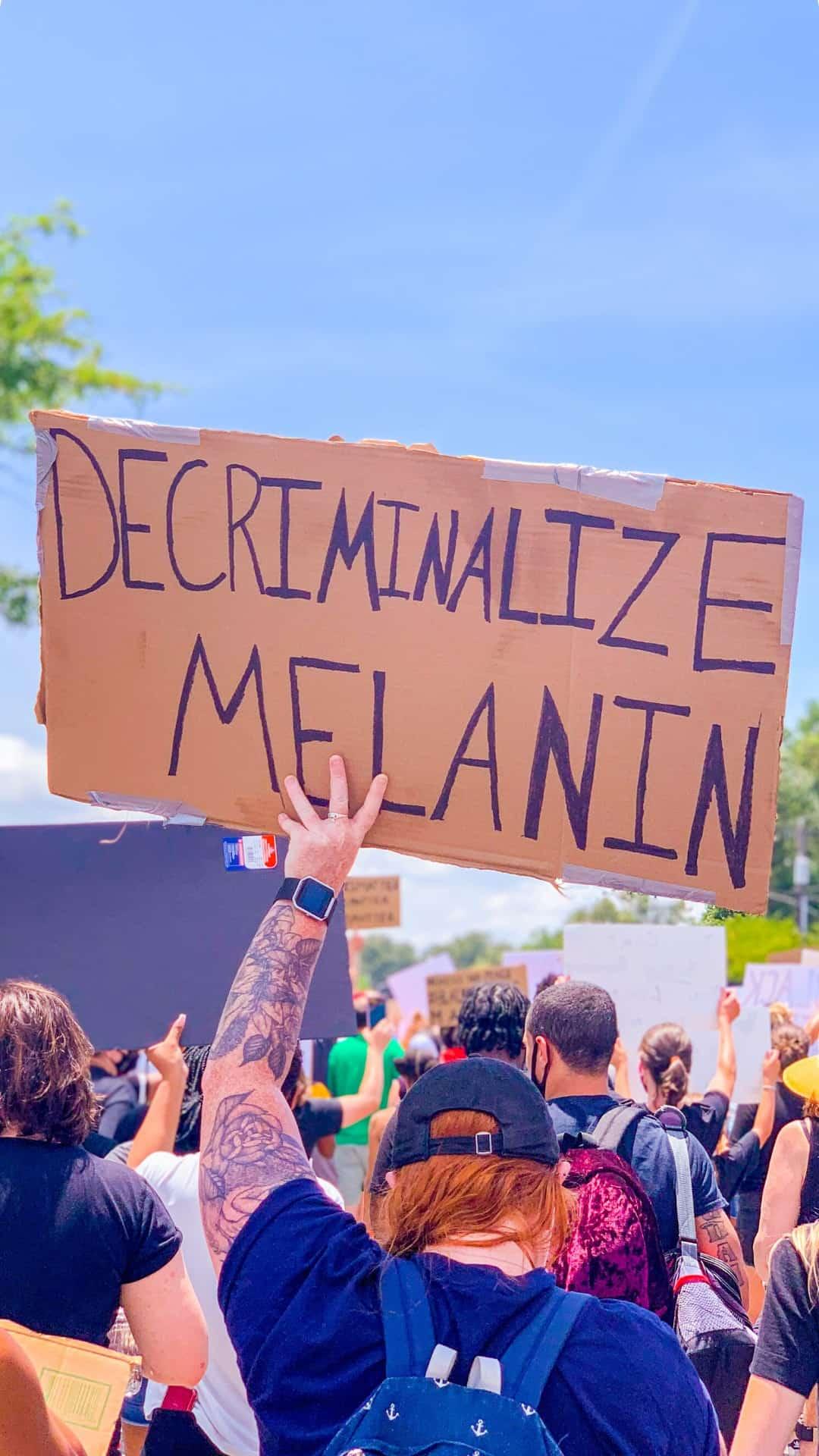decriminalize melanin protest sign