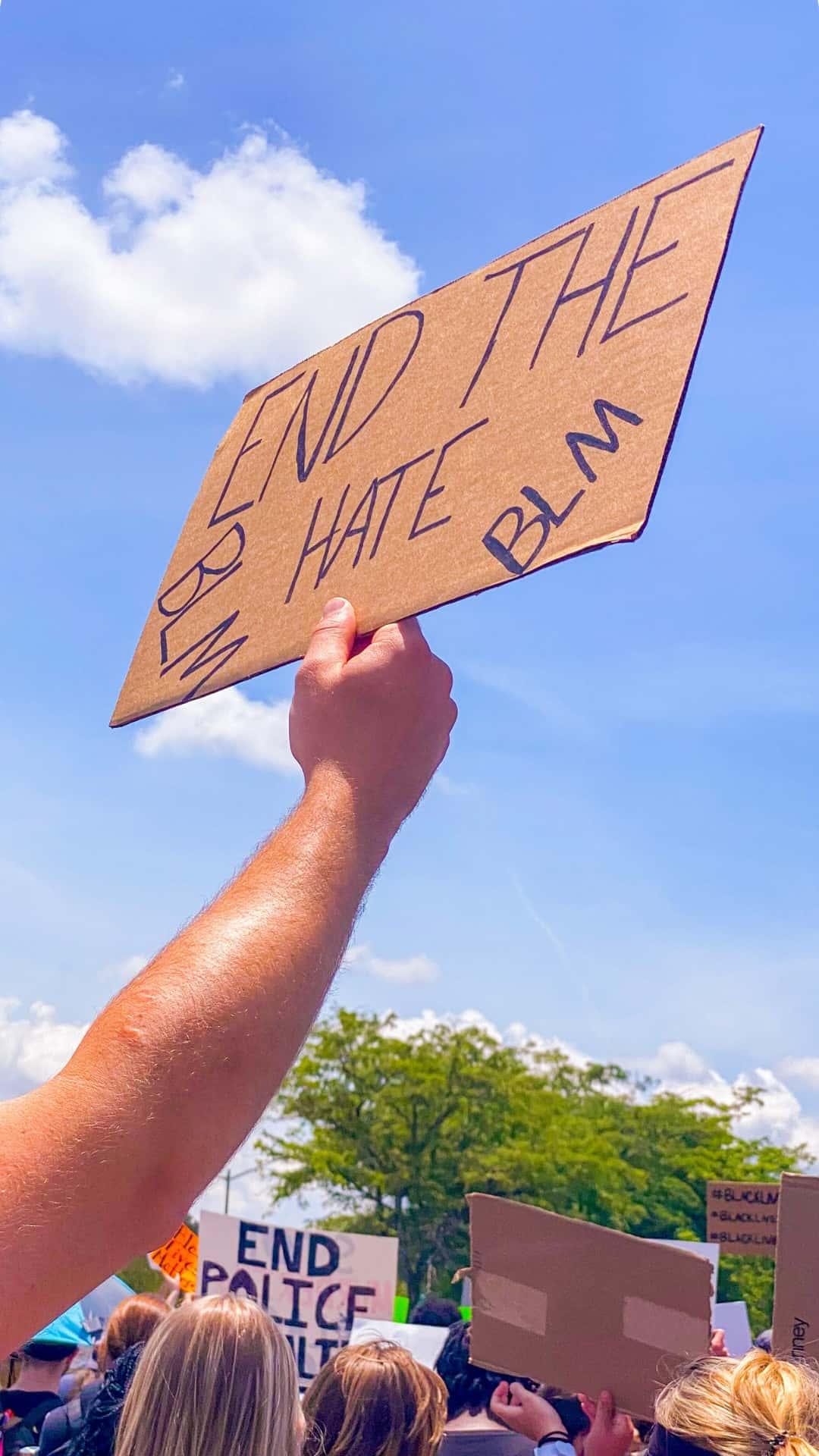 end the hate protest sign