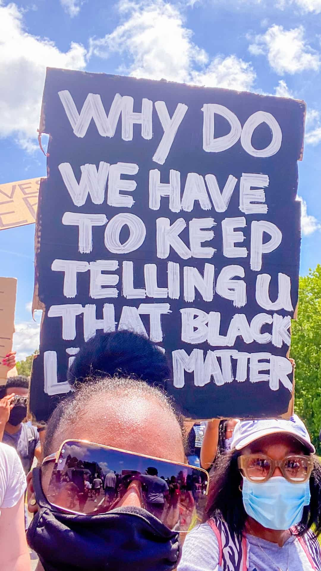 why do we we have to keep tell you Black lives matter? protest sign