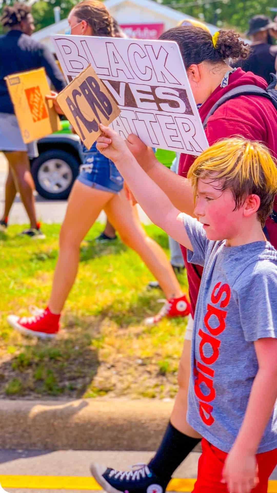 kids Black Lives Matter protest signs