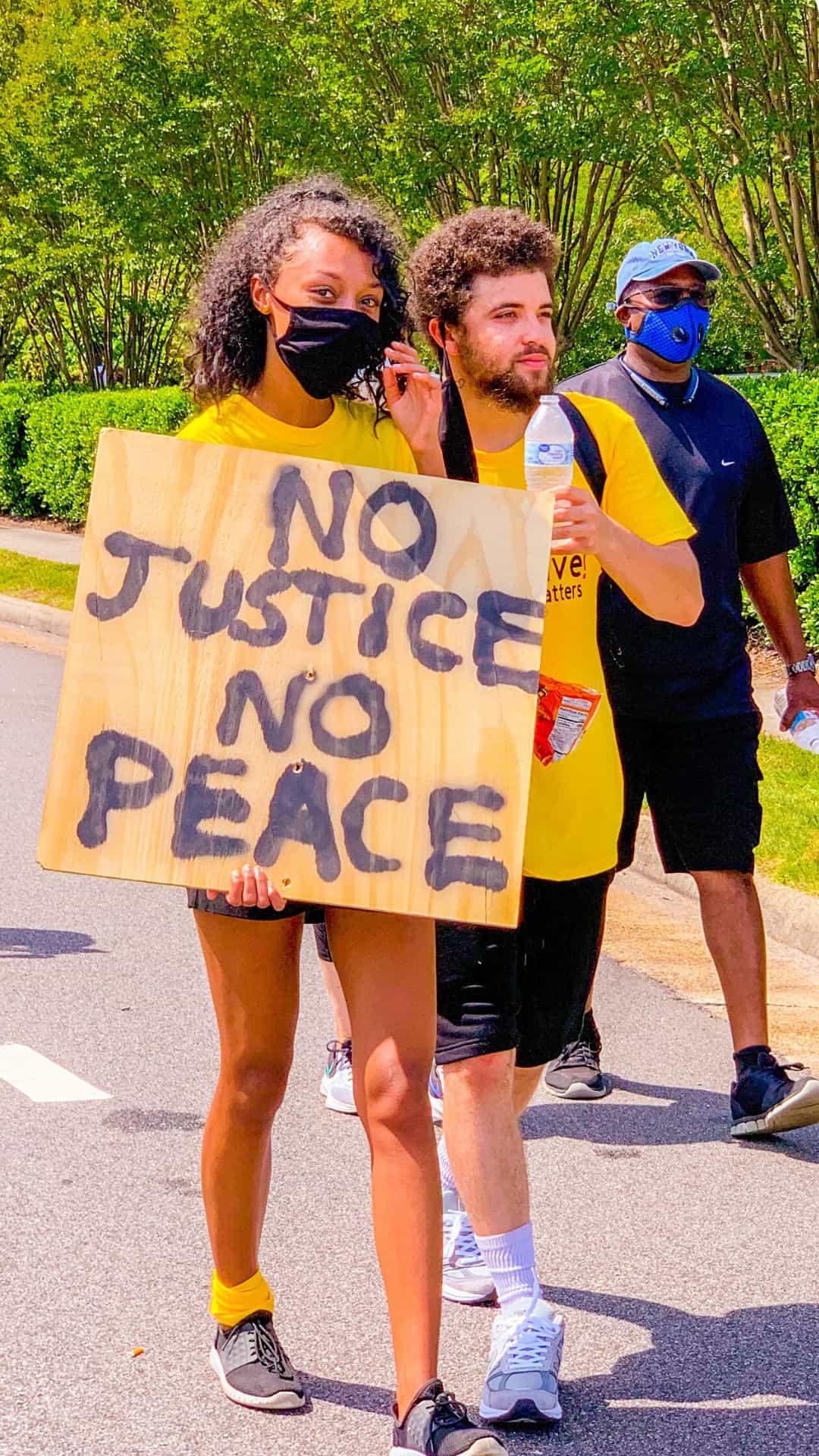 no justice no peace Black lives matter protest sign