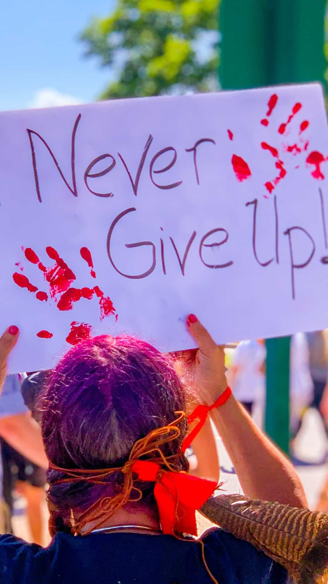 never give up protest sign