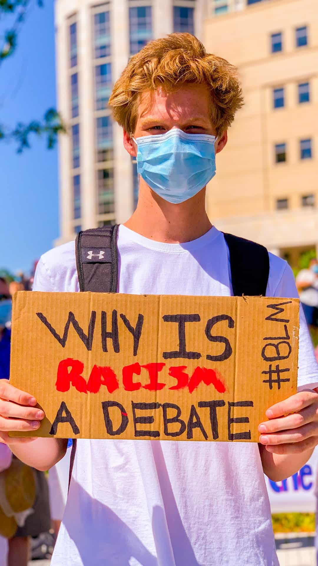 BLM Protest Signs Ideas- why is racism a debate protest sign
