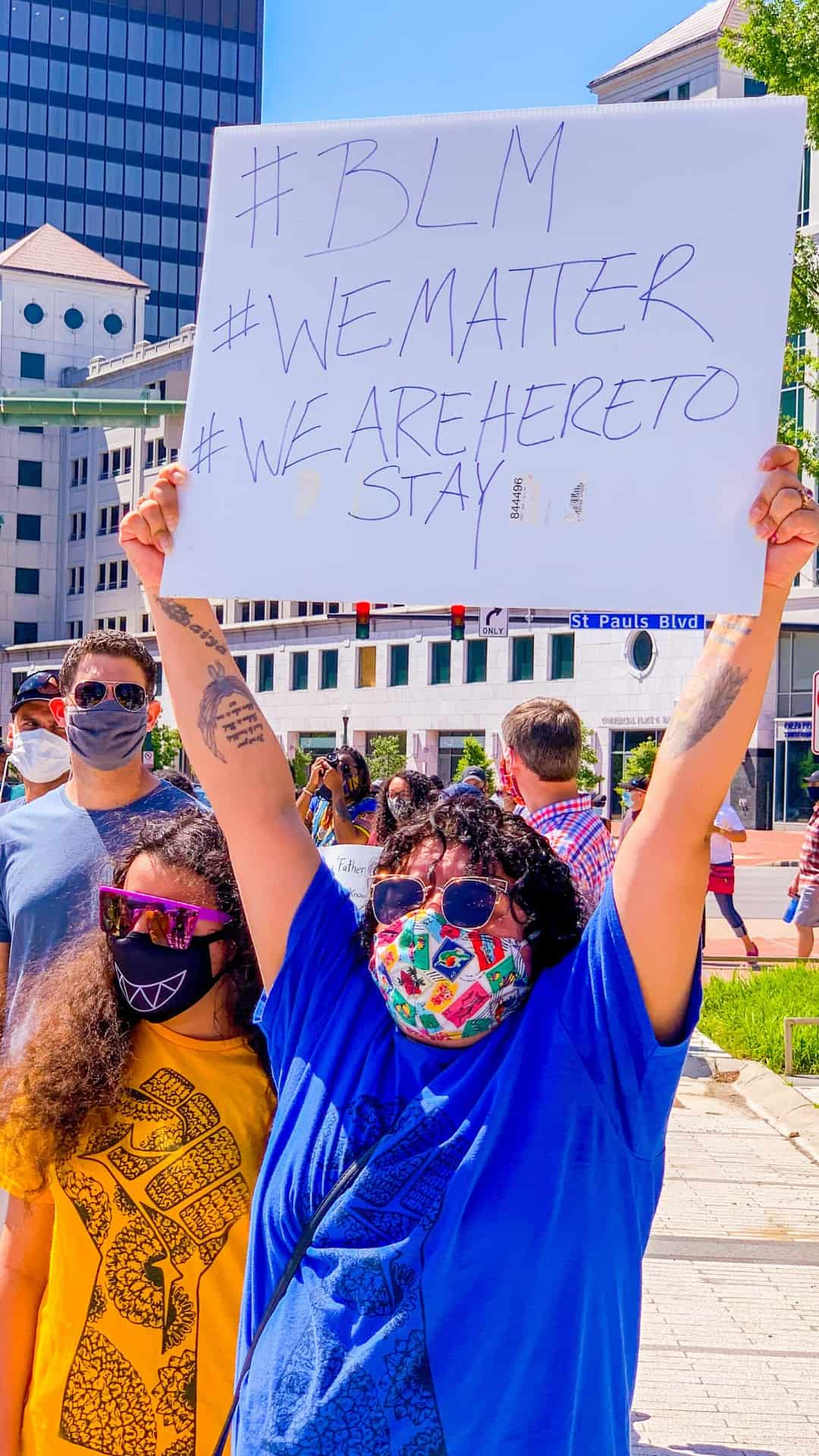 BLM we are here to stay protest sign