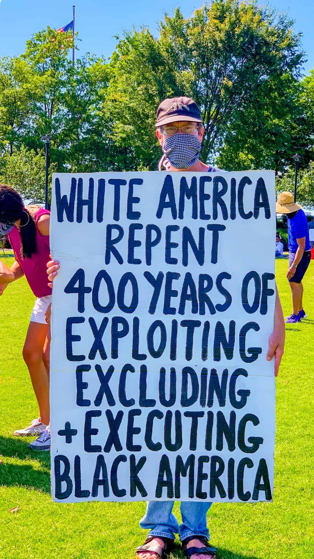 White America repent 400 years protest sign