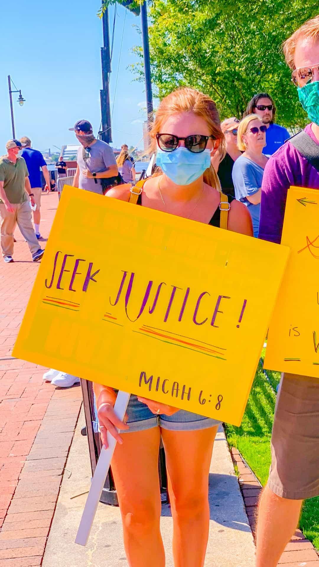 Seek justice Micah 6:8 protest sign