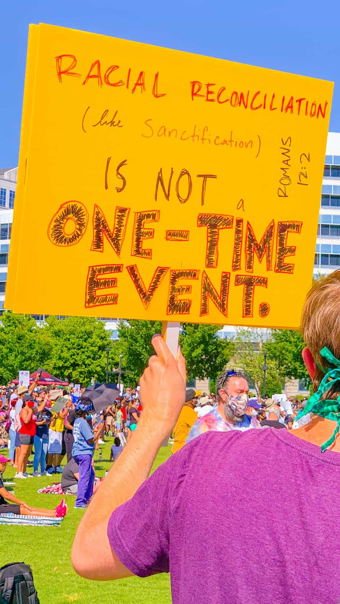 racial reconciliation is not a one-time event protest sign