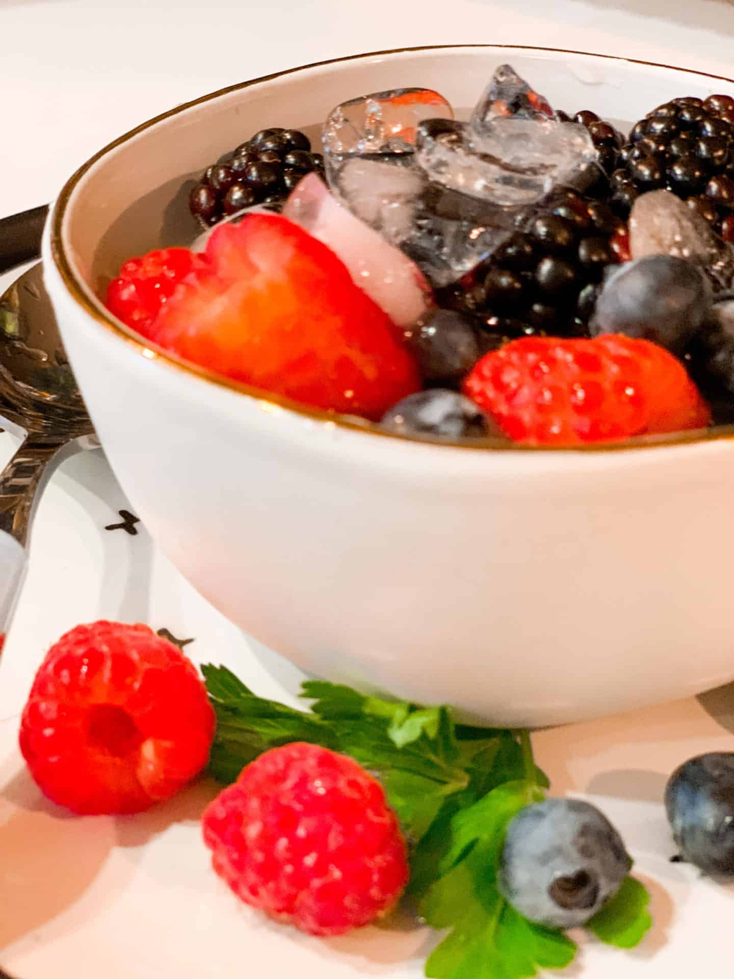 Nature's Cereal Recipe- Raspberries, Blueberries & Blackberries In A Bowl Of Coconut Water With Ice