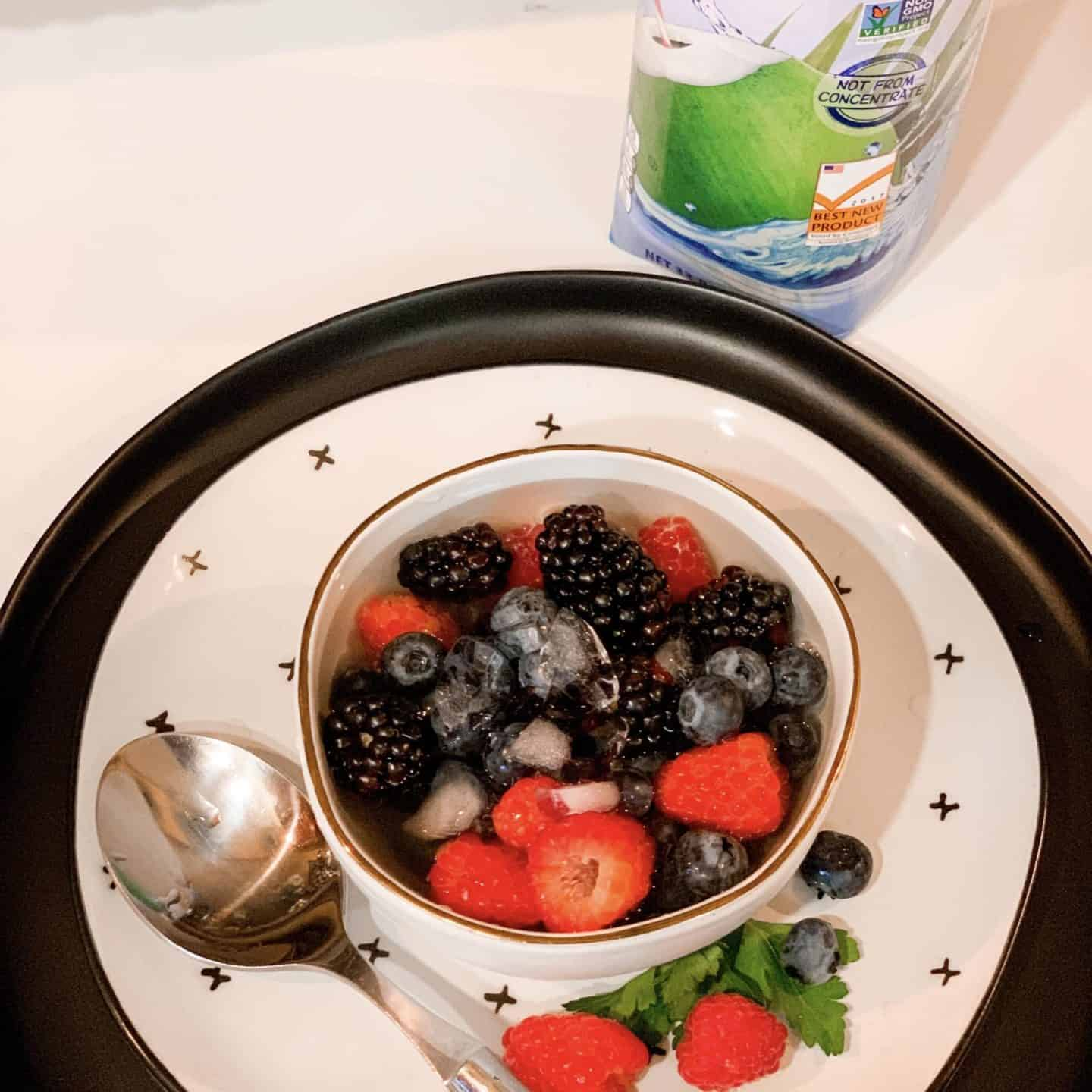 Photo From The Video How To Make Nature's Cereal Recipe- Raspberries, Blueberries & Blackberries In A Bowl Of Coconut Water With Ice & A Spoon